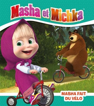 Masha et Michka. Masha fait du vélo